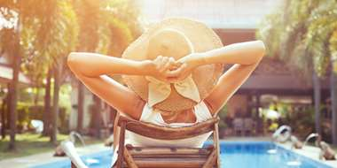 woman relaxing by pool during sunny afternoon summer
