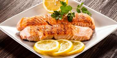 grilled salmon with light sauce and lemon